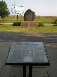 Plaque describing the Irish Commemorative Stone that is located across the street of the monument.